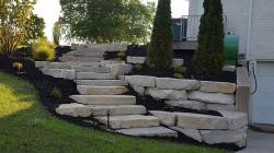 Silver Creek outcropping stone retaining wall with steps